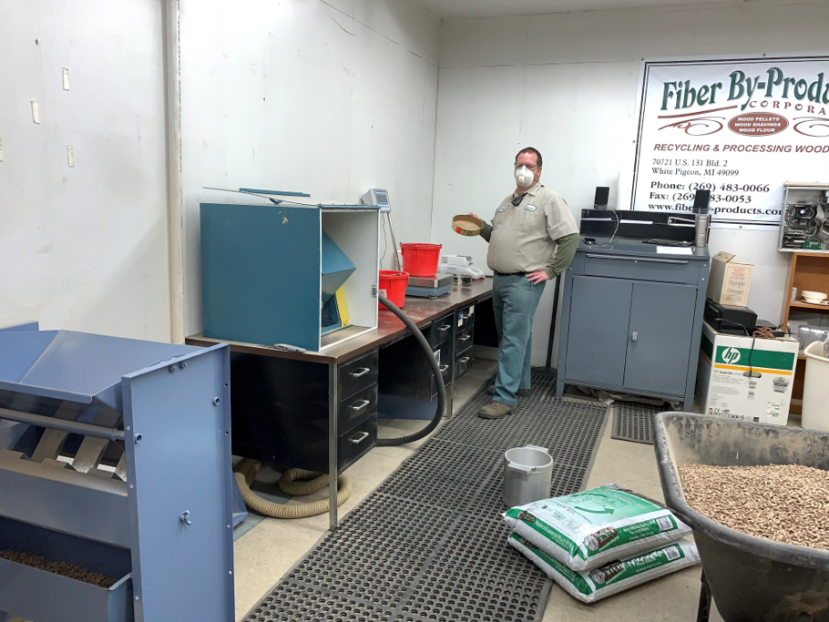 Photo Caption: Fiber By-Products--Corp.'s packaging and PFI-certified lab technician works his magic to ensure pellet fuel is meeting—and exceeding—PFI Standards Program requirements.
